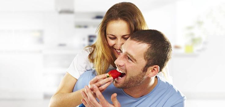 man eating strawberry fruit
