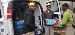 Students Give Bottled Water to Senior Citizens in Flint, Michigan