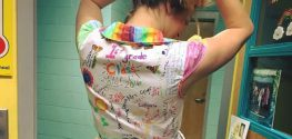 Teacher Wears Students' Art to Remember Them