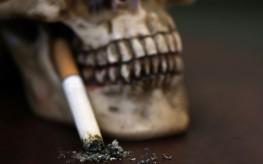 cigarette in skull mouth