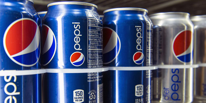 Cans of PepsiCo. Inc. Pepsi and Diet Pepsi soda are displayed for a photograph in San Francisco, California, U.S., on Wednesday, Feb. 13, 2013. PepsiCo Inc. said fourth-quarter profit rose 17 percent, helped by higher prices, and authorized a new plan to repurchase as much as $10 billion in stock as the world?s largest snack-food maker returns cash to investors. Photographer: David Paul Morris/Bloomberg via Getty Images