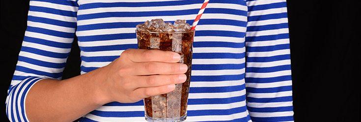 person drinking soda