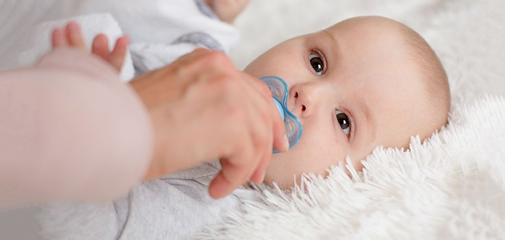 Sucking on Your Infant's Pacifier Could Protect Them from Allergies