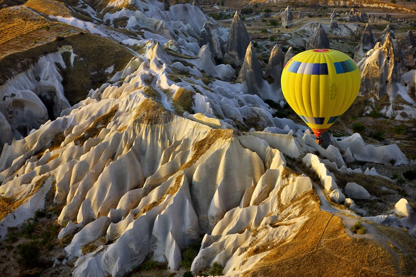 Hot air balloon flight over Cappadocia, a historical region in Central Anatolia, largely in Nevşehir Province, in Turkey.