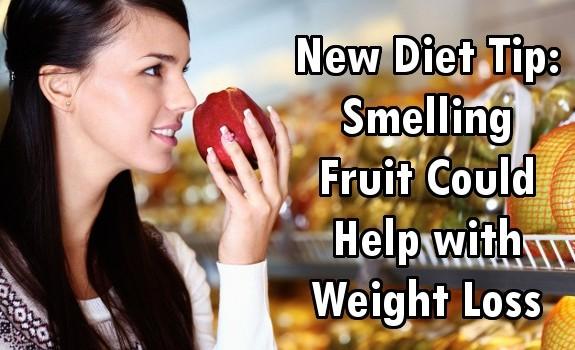 smelling fruit