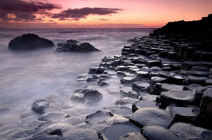 Giant's Causeway. An area of about 40,000 interlocking basalt columns, the result of an ancient volcanic eruption. It is located in County Antrim on the northeast coast of Northern Ireland, about three miles northeast of the town of Bushmills.
