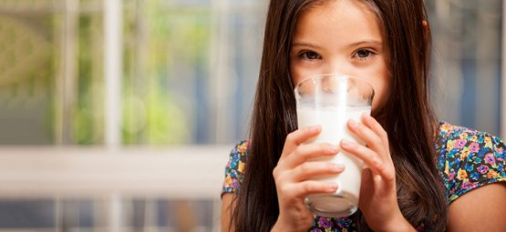 kid drinking raw milk