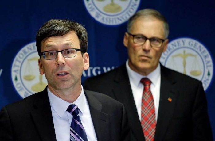 Washington Attorney General Bob Ferguson, left, speaks as Gov. Jay Inslee looks on during a news conference where the lawsuit was announced. Source: Houston Chronicle